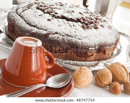 Chocolate Cake with cup of coffee and nuts. - stock photo