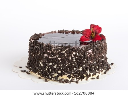 Chocolate Cake with decoration on light background, cake isolated on light background with selective focus. Birthday cake. Cake. Cake decorated with red flower - stock photo