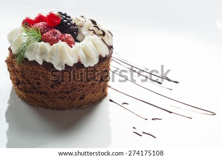 chocolate cake with fruits and cream - stock photo