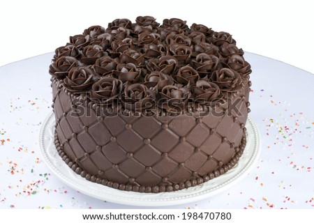 Chocolate Cake with handmade Chocolate frosting roses top angle view - stock photo