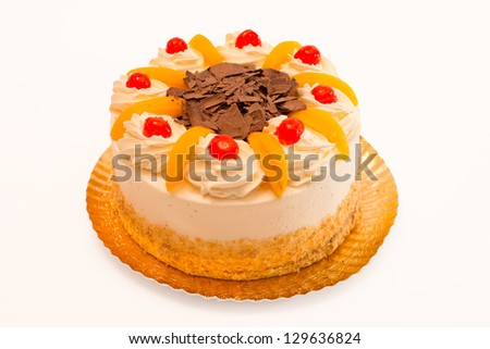 Chocolate cake with icing and cream isolated on white background - stock photo