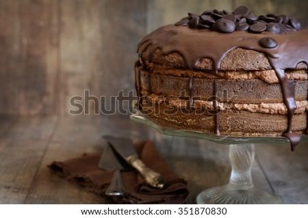 Chocolate cake with mascarpone on rustic background. - stock photo