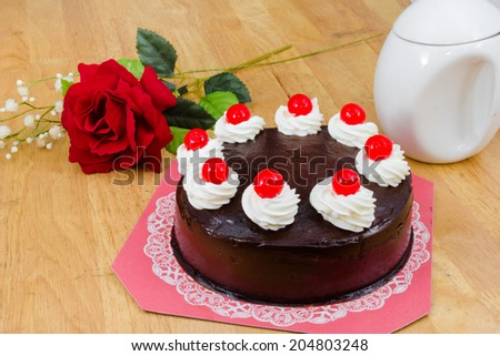 chocolate cake with red Jelly on top - stock photo