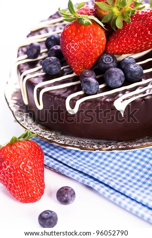 chocolate cake with strawberries on a plate