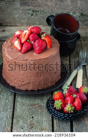 Chocolate cake with strawberries, selective focus - stock photo