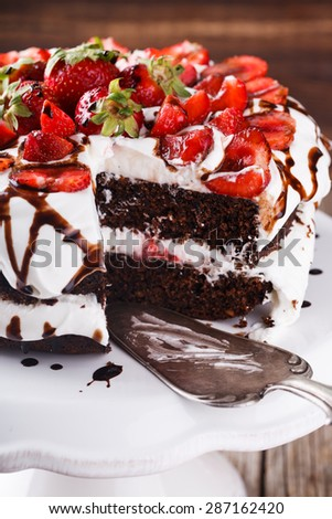 Chocolate cake with whipped cream and strawberries.selective focus - stock photo