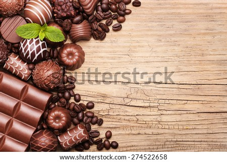 Chocolate candies. Collection of beautiful Belgian truffles on wooden background - stock photo