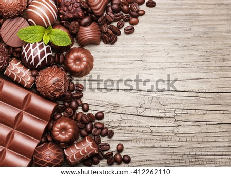 Chocolate candies. Collection of beautiful Belgian truffles on wooden background