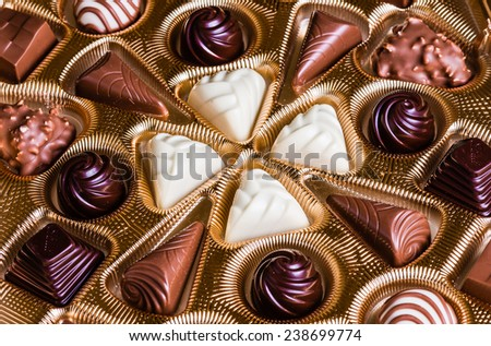 Chocolate candies in a box - stock photo