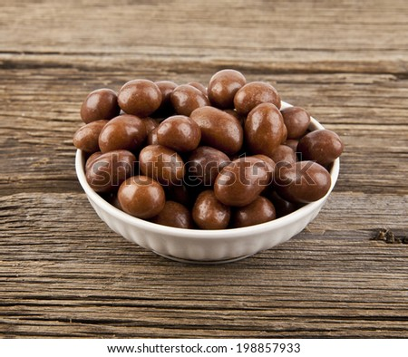 chocolate candies on a wooden background