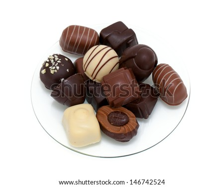chocolate candies on glass plate - stock photo