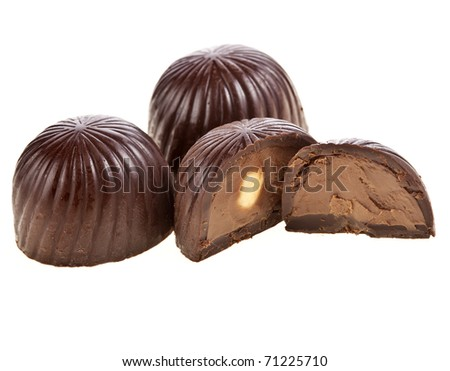 Chocolate candies with hazelnut isolated on white
