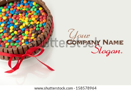 Chocolate candy cake attached with a ribbon - stock photo