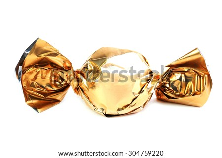 Chocolate candy in golden wrapper isolated on white