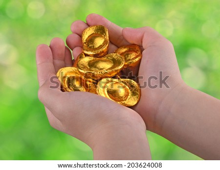 Chocolate candy in the child's hand. - stock photo