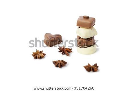 Chocolate candy tower on white background with badiane spice - stock photo
