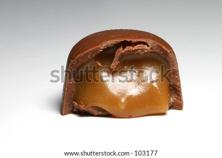 Chocolate candy with caramel center. - stock photo