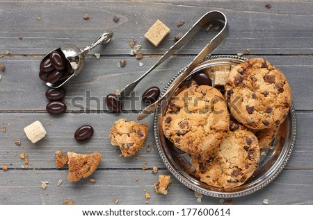 Chocolate candy with chocolate chip cookies on wooden background - stock photo