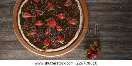 Chocolate candy with strawberry pie  - stock photo