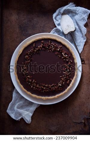 Chocolate Caramel Pecan Tart - stock photo