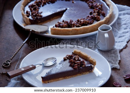 Chocolate Caramel Pecan Tart - stock photo