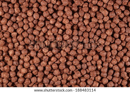 Chocolate cereal balls as background texture - stock photo