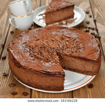 Chocolate cheesecake on a brown background - stock photo