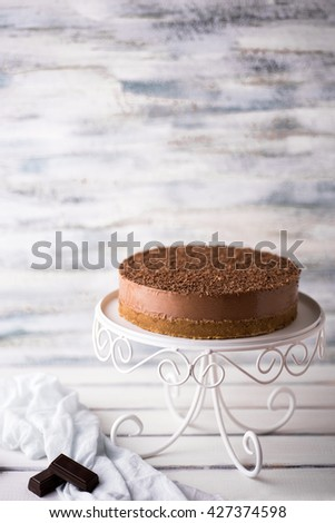 Chocolate cheesecake on a cake stand