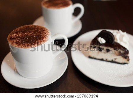 chocolate cheesecake with a cup of coffee - stock photo