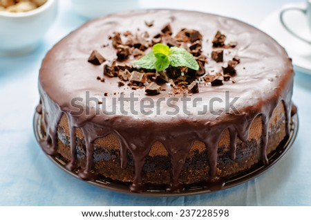 chocolate cheesecake with chocolate glaze on blue background. tinting. selective focus - stock photo