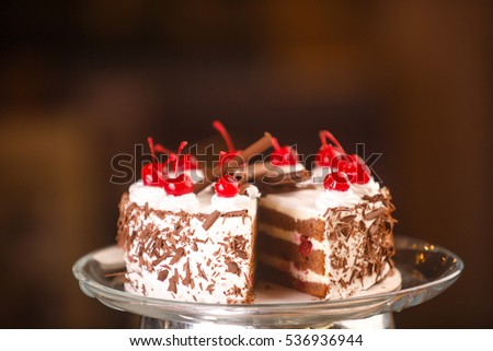 chocolate cheesecake with chocolate glaze on white wood background. tinting. selective focus
