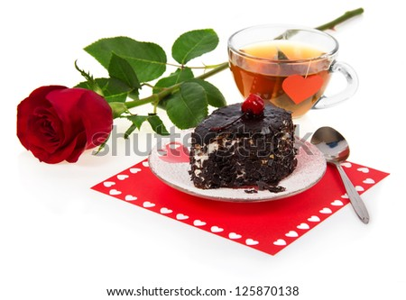 Chocolate cherry cake, hot tea and red rose isolated on white - stock photo