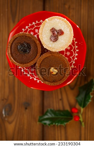 Chocolate Cherry Mini Tartlets in festive golden red style, shallow dof - stock photo