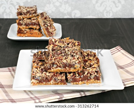Chocolate chip and nut cookie bars, close up with copy space. - stock photo