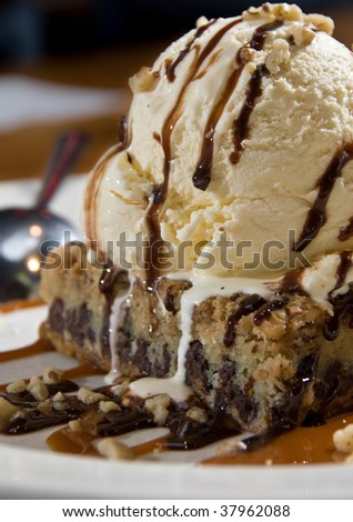 Chocolate chip brownie sundae with caramel and fudge - stock photo