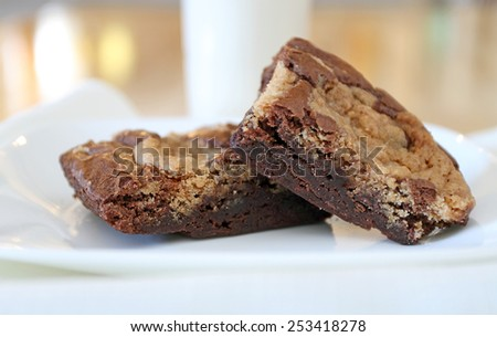 Chocolate chip cookie brownies with milk - stock photo