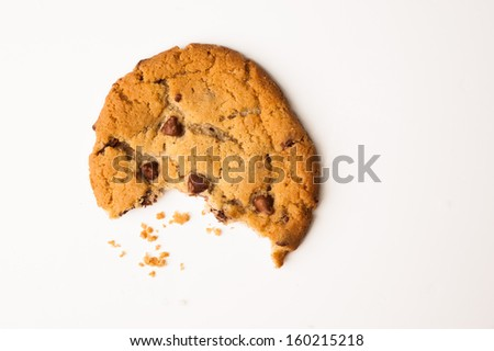 Chocolate Chip Cookie with a Bite Taken Out - stock photo