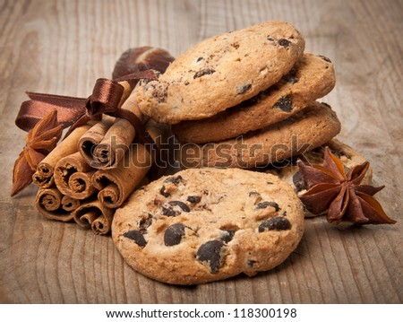 chocolate chip cookies and cinnamon sticks - stock photo