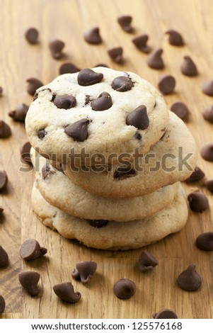 Chocolate chip cookies and scattered chocolate chips - stock photo
