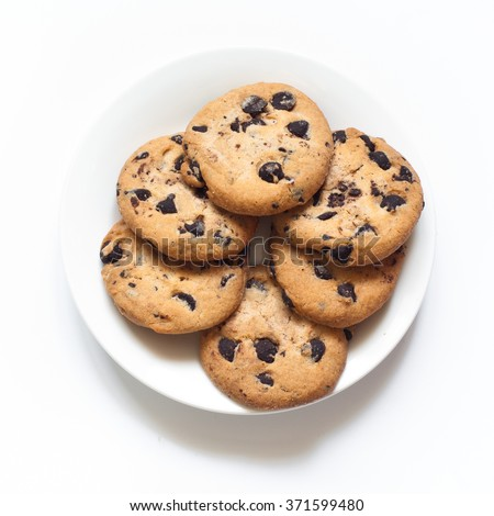 Chocolate chip cookies at the plate isolated on white. - stock photo