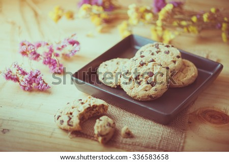 Chocolate chip cookies in black ceramic dish at cafe in morning time with vintage filter effect - stock photo