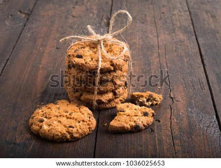 Chocolate chip cookies on rustic wooden backgrou