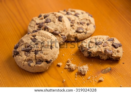 Chocolate chip cookies on wood background. - stock photo