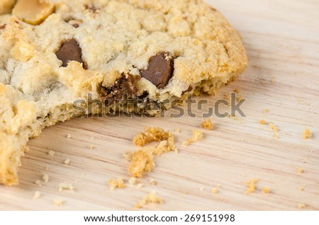 Chocolate chip cookies on wooden table. - stock photo