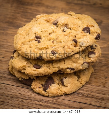 Chocolate chip cookies stack on wooden table - stock photo