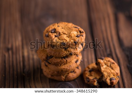 Chocolate chips cookies on dark brown wooden background
