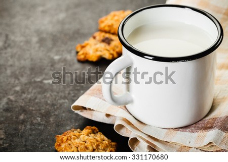 Chocolate chips cookies with nut and chocolate, milk on old rusty background - stock photo