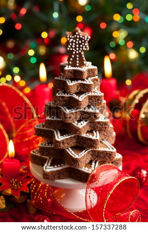 Chocolate Christmas tree on the festive table - stock photo