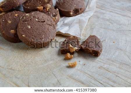 Chocolate cookie with Cashews on wooden background