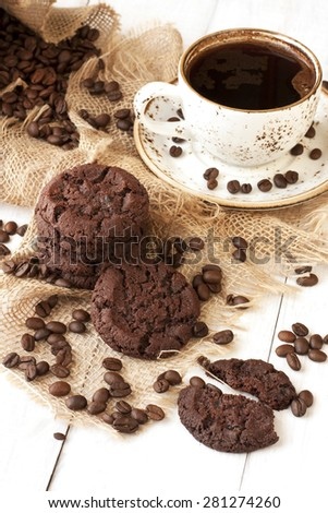 Chocolate cookies and cup of aromatic coffee  - stock photo